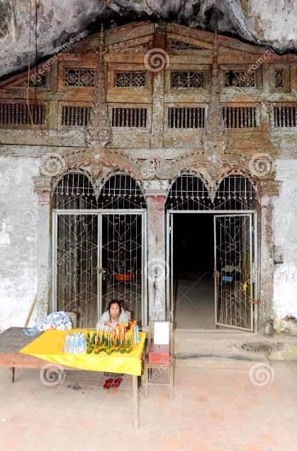 pak-ou-caves-luang-prabang-laos-january-cashier-sitting-entrance-86442826.jpg